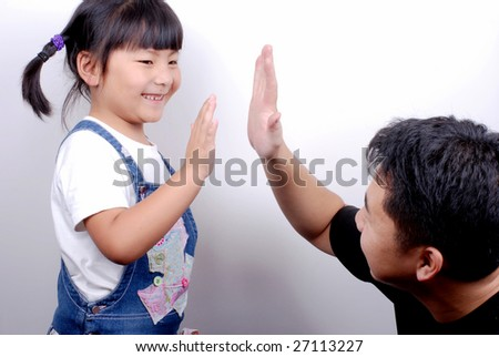 give me five, adult and child - stock photo