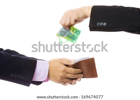 Give money from businessman to another - stock photo