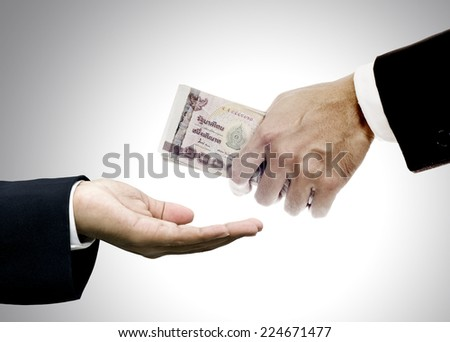 Give money to brokers - stock photo