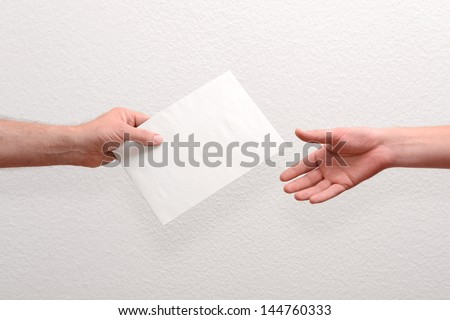 Give someone money in envelop for corruption purposes - stock photo