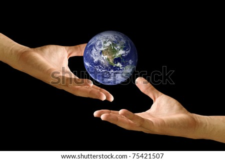 Give the world to other hand - stock photo