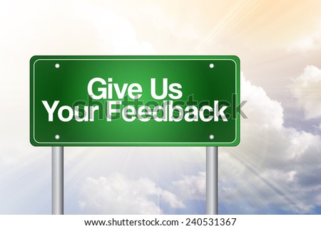 Give Us Your Feedback Green Road Sign, Business Concept  - stock photo