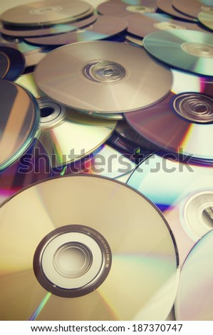 Given a set of DVDs scattered on a table - stock photo