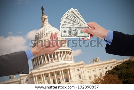 Giving a bribe, hands of businessmen or politicians - stock photo