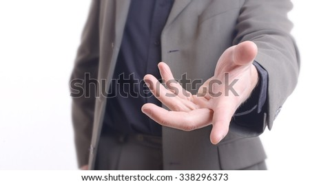 Giving a helping hand, asking or offering help close-up shot of a caucasian man in a business suit - stock photo