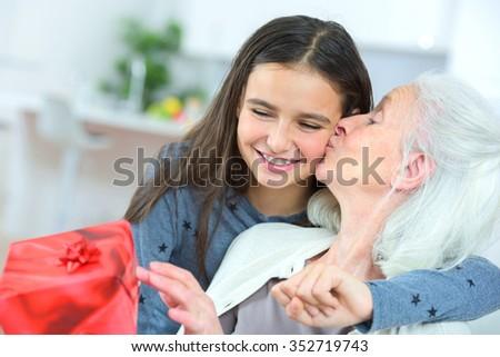 Giving grandma a gift - stock photo