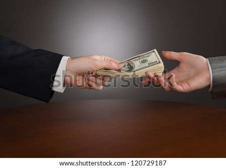Giving money - stock photo