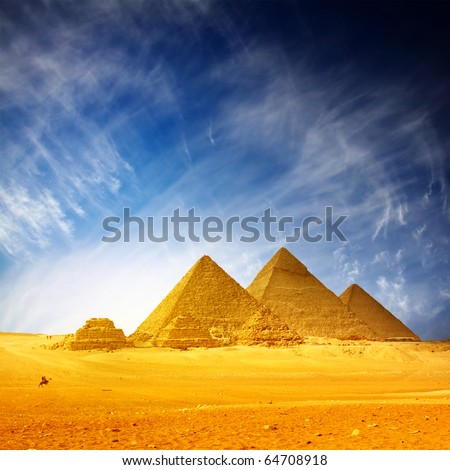 Giza pyramids and blue sky with clouds - stock photo