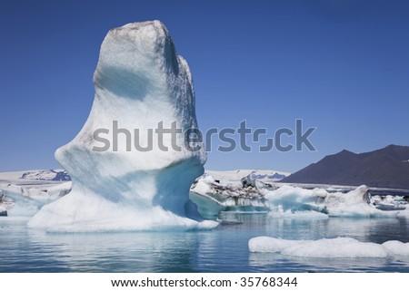 Glacial icebergs floating on the Iceberg Lagoon, Jokulsarlon, Iceland - stock photo
