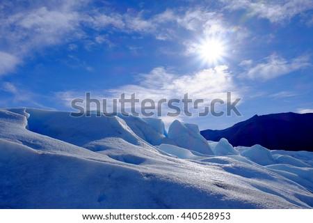 Glacier and the sun at Perito Moreno Glacier in Patagonia, Los Glaciares National Park, Argentina - stock photo