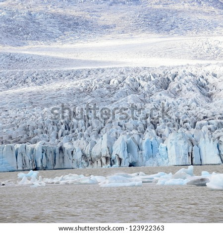 glacier breaks into lagoon - stock photo
