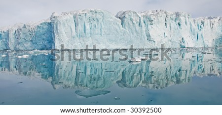 Glacier in summer on Spitsbergen island, Arctic - stock photo