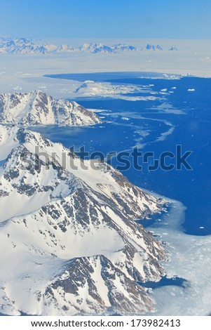 Glaciers and icebergs of Greenland, Beautiful view of mountains, Snowy peaks  - stock photo