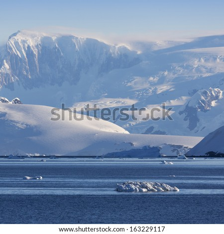 Glaciers and icebergs. Travel on deep pure waters among ices of Antarctica. Fantastic snow landscapes. - stock photo
