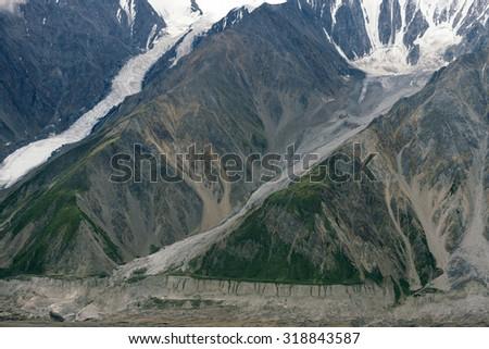 Glaciers Flowing Down Mountain in Kluane National Park, Yukon - stock photo