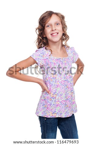 glad little girl looking at camera and smiling. studio shot over white background - stock photo