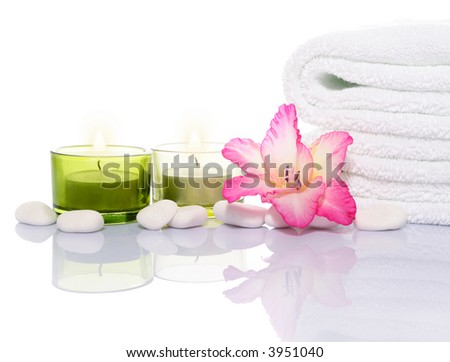Gladiola, Candles, Towel and White Stones on White Background - stock photo
