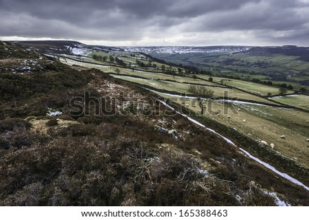 Glaisdale, Yorkshire, UK. Snow over the north York Moors National Park showing the valley at Fryup  and the undulating landscape near Glaisdale dale, Yorkshire, UK. - stock photo