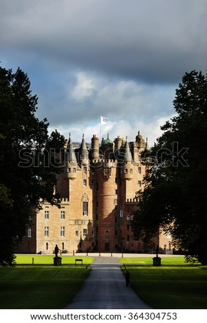 Glamis castle with dramatic light. Known as one of the most haunted castles in Scotland. - stock photo