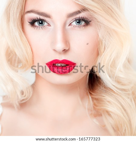 glamor closeup portrait of beautiful sexy blonde model with bright makeup, with red lips, with perfect clean skin in studio - stock photo
