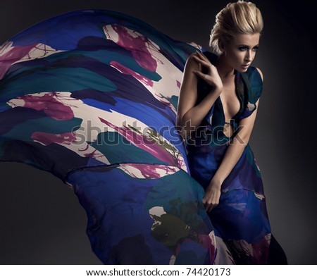 Glamor girl wearing beautiful dress - stock photo