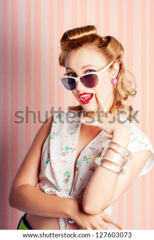 Glamor Retro 1960s Blond Woman With Immaculately Coiffed Hair And Sunglasses Peering Over The Top With Her Finger To Cheek In A Fashion Idea Concept - stock photo