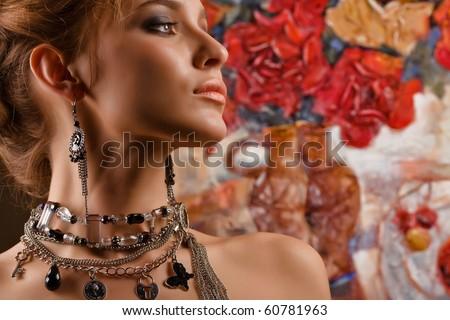 Glamorous. A portrait of a glamorous woman wearing beautiful jewelery - stock photo