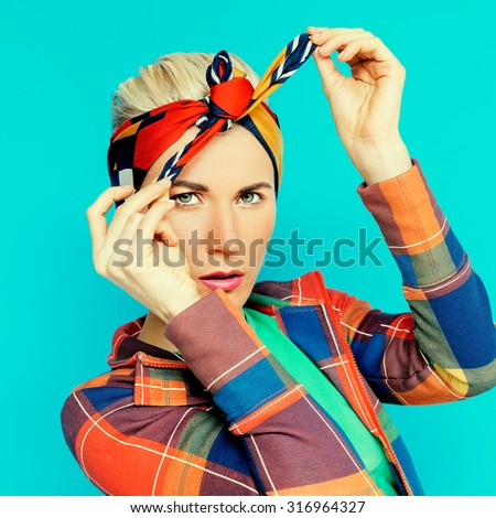 Glamorous Blonde learns to tie Headscarf - stock photo