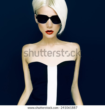 Glamorous Blonde on Black background  Fashion Style - stock photo