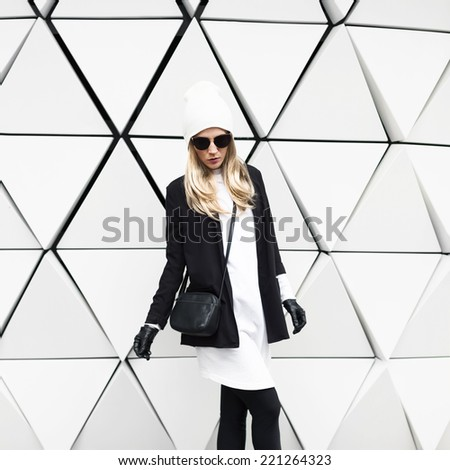 Glamorous Blonde standing at the wall. Urban Fashion Black and White  Style - stock photo