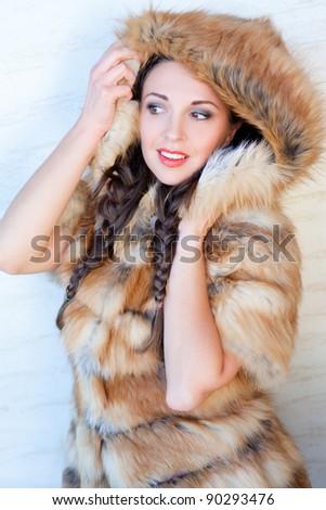 Glamorous brunette wearing fox fur - stock photo