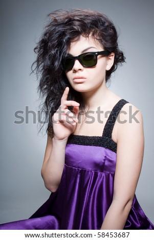 Glamorous chick pretending to be serious - stock photo