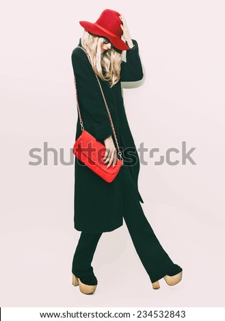 Glamorous Fashion blond Girl in classic black Coat and red Hat. Autumn Style - stock photo