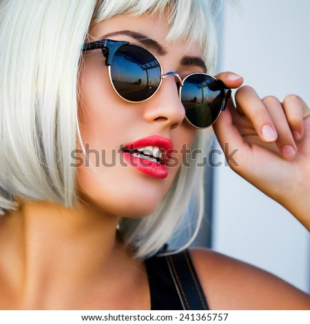 Glamorous fashion lady go shopping . Close up fashion portrait of a beautiful young woman in white wig  stylish retro sunglasses and bright red full lips. - stock photo