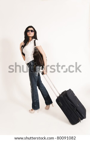 glamorous Indian girl leaving for journey and boarding on a plane. - stock photo