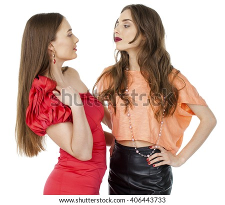 Glamorous portrait of two young beautiful women isolated on white background - stock photo