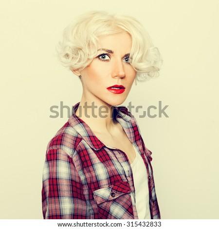 Glamorous sensual Blonde in checkered Shirt. - stock photo