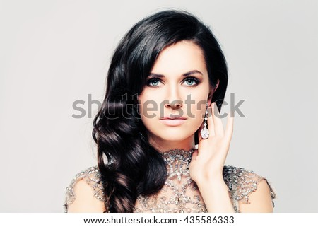 Glamorous Woman with Curly Hairstyle. Cute Face - stock photo