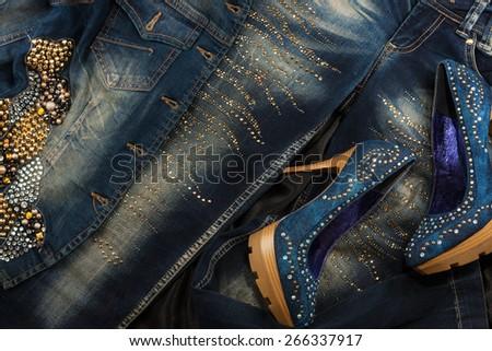 Glamorous women's fashion, jeans, shoes, jacket in rhinestones - stock photo