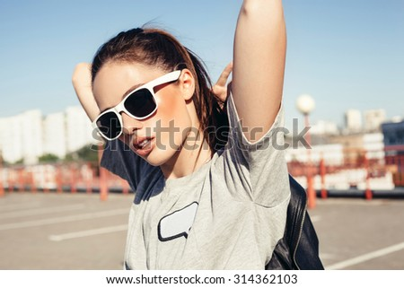 Glamorous young sexy woman in white sunglasses. Outdoor lifestyle portrait - stock photo