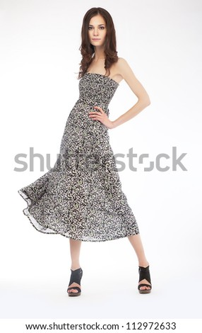 Glamorous young woman in modern casual dress on white background - stock photo