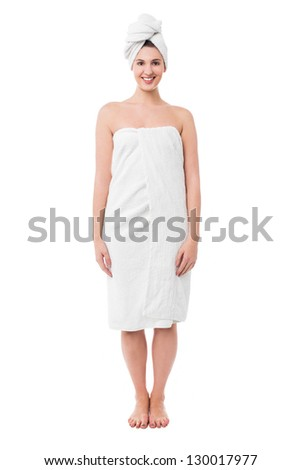Glamorous young woman in towel, full length portrait. - stock photo