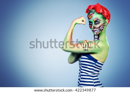 Glamorous zombie girl. Portrait of a pin-up zombie woman. Body-painting project. Halloween make-up. - stock photo