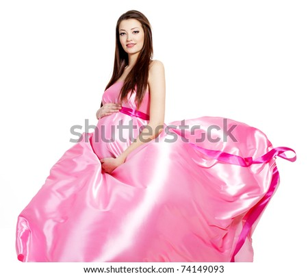Glamour ans stylish  pregnant beautiful woman in pink blowing dress - white background - stock photo