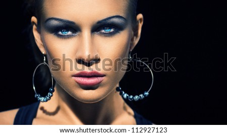 Glamour brunette with make-up and big earrings - stock photo