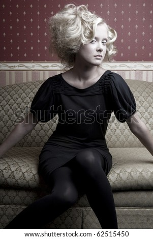 glamour girl on the sofa - stock photo