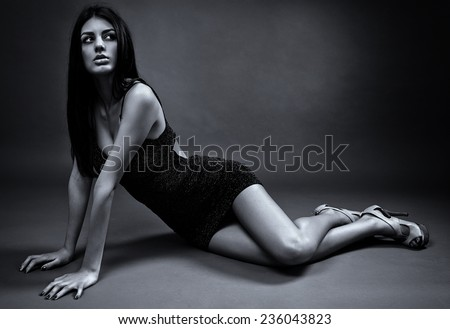 Glamour image of a beautiful latin young woman, monochrome toned - stock photo