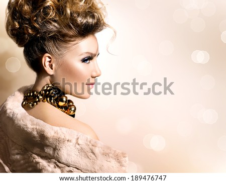 Glamour lady portrait in luxury fur coat. Beautiful model girl with perfect fashion makeup and hairstyle. Trendy accessories.  - stock photo