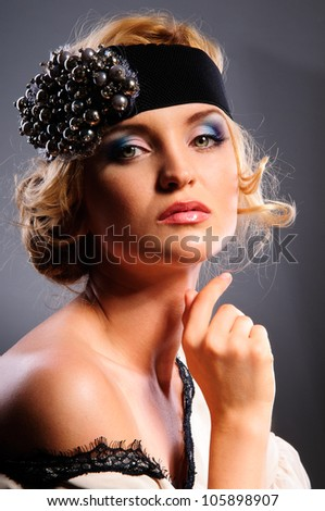 Glamour portrait of beautiful blonde woman model with fresh daily makeup and romantic wavy hairstyle. Fashion shiny highlighter on skin, sexy gloss lips make-up. on gray background - stock photo