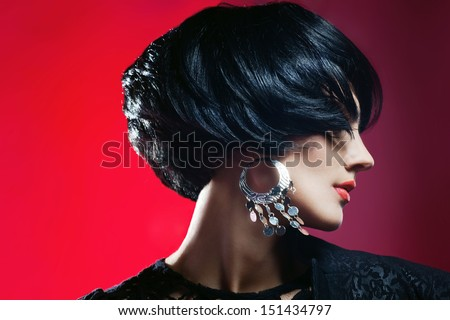 Glamour portrait of beautiful fashion model  in Black Dress posing with exclusive jewelry. Professional makeup and hairstyle - stock photo